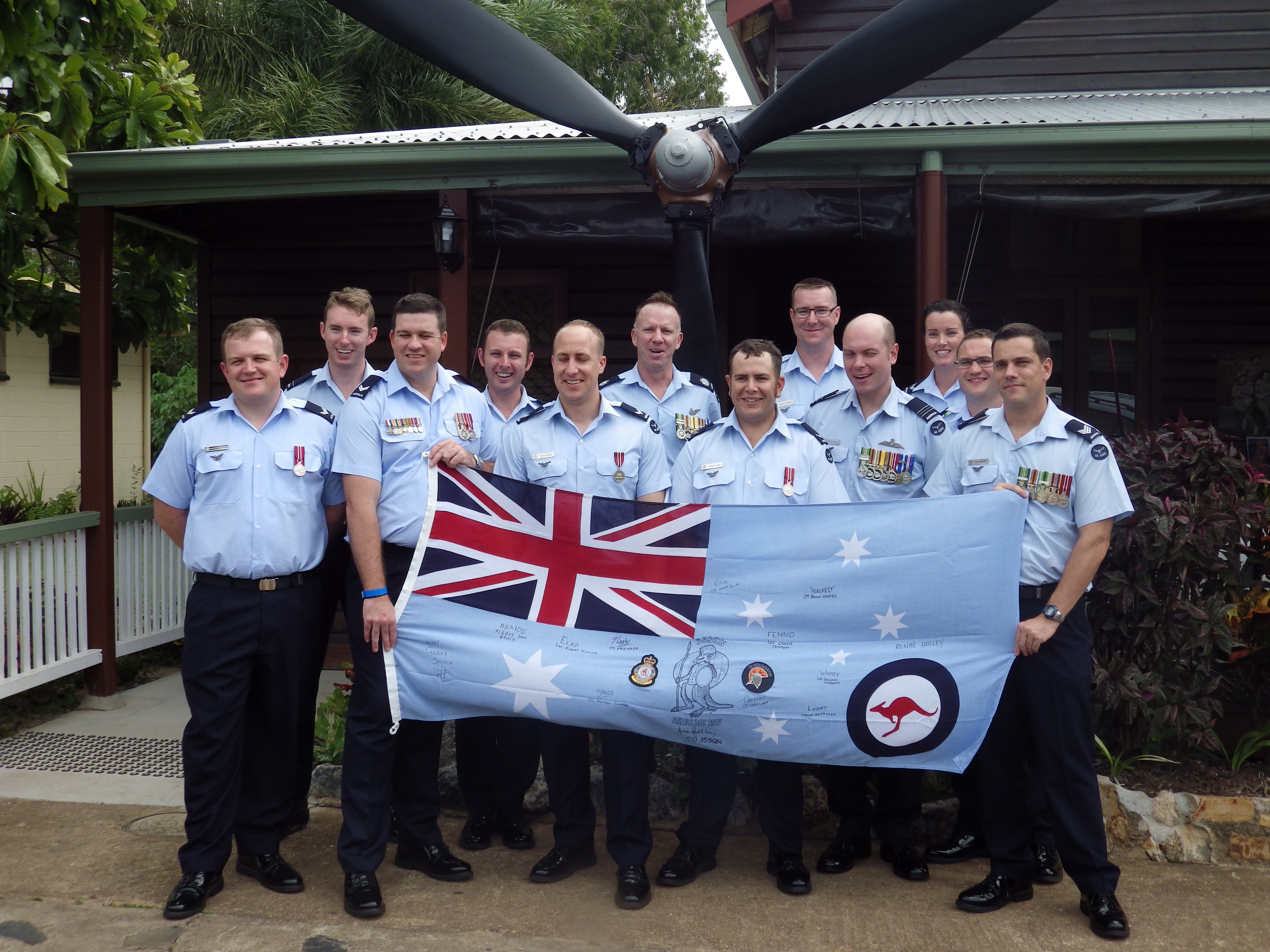 38 Sqn with newly signed flag