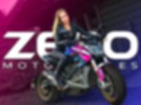 Model sitting on motorcycle Zero SRF Electric Motorcycle