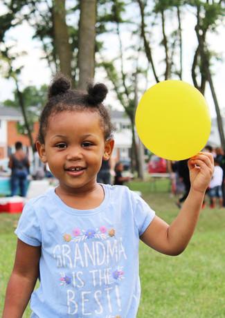 Girl with balloon, MacArthur Boulevard Community Fun Day