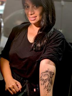 woman gold fish tattoo.jpg