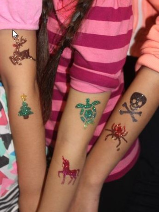 arms with glitter tattoos.jpg