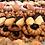 Thumbnail: Blik rond gevuld met koekjes