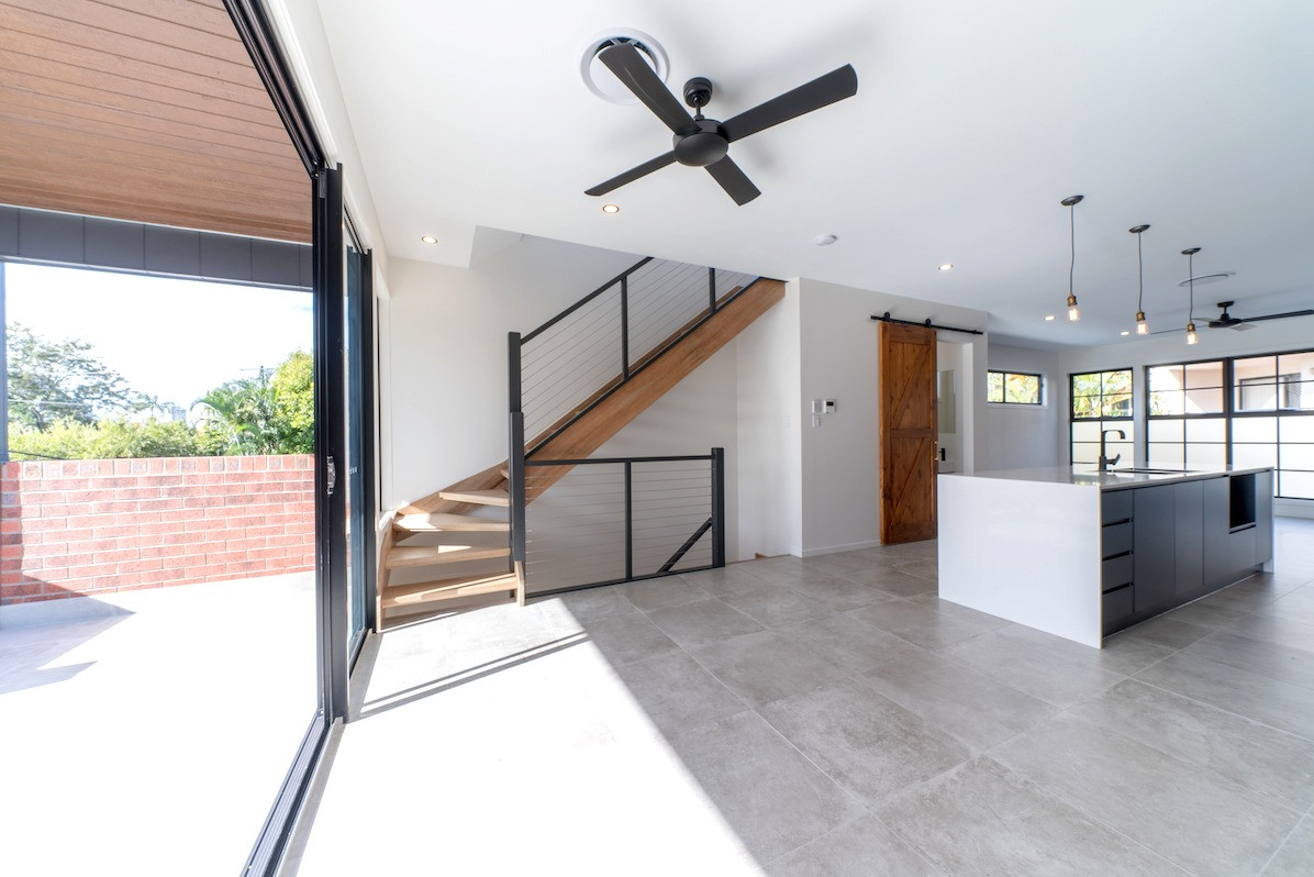Open plan living to large balcony
