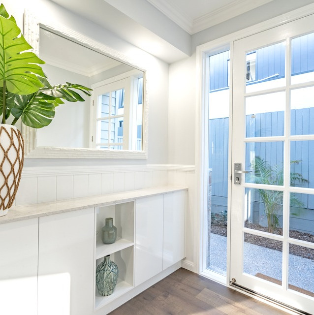 Beautiful light filled laundry with french doors