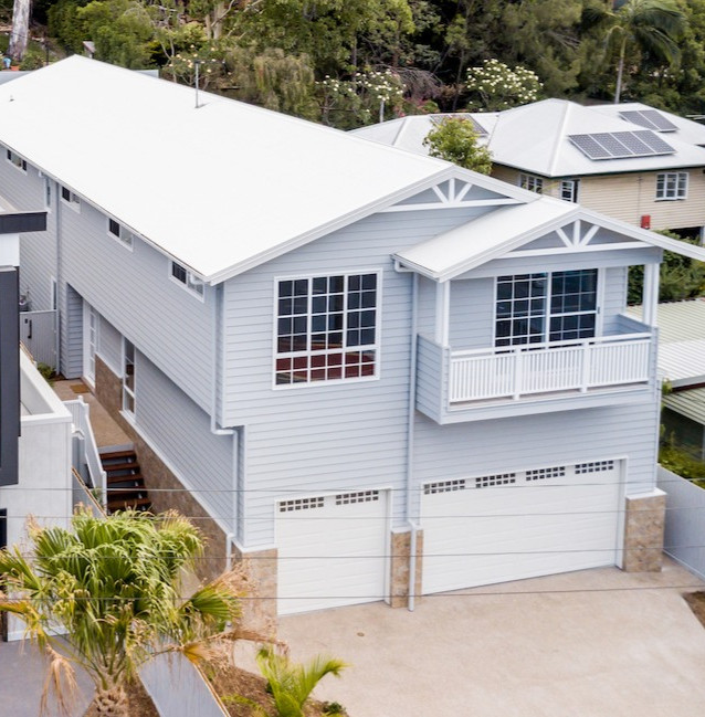 Understated street appeal with clever 3 car garage