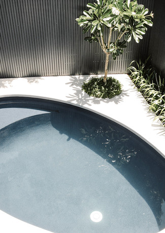 Fully tiled oval pool compliments alfres