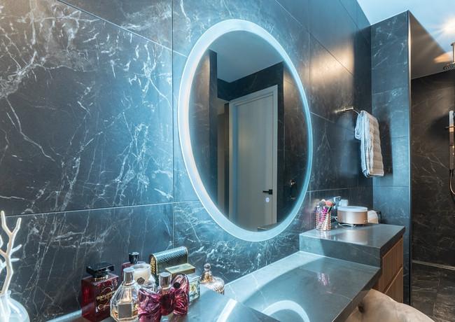 Backlit round mirror in master ensuite