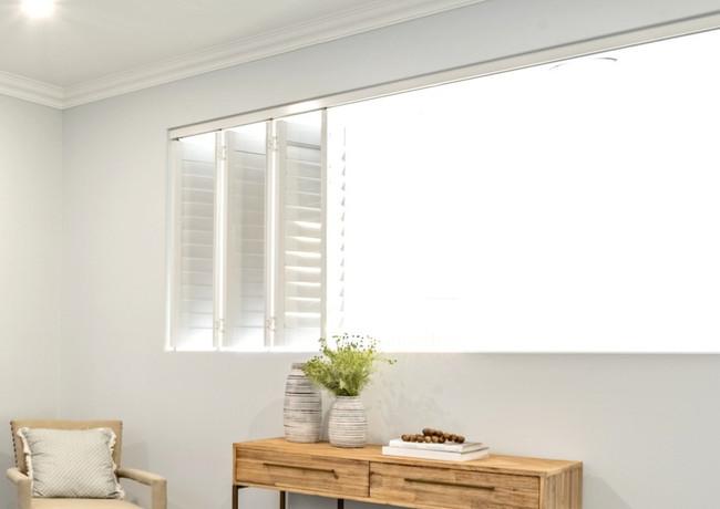 Master bedroom opening to void via beautiful bifolds windows - custom builds
