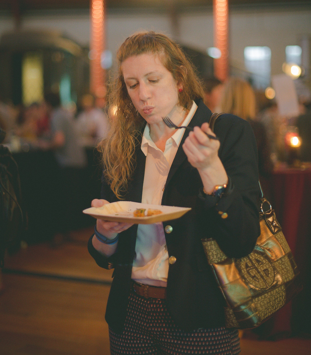 Person tasting food at Farm to Chef 2017 event.