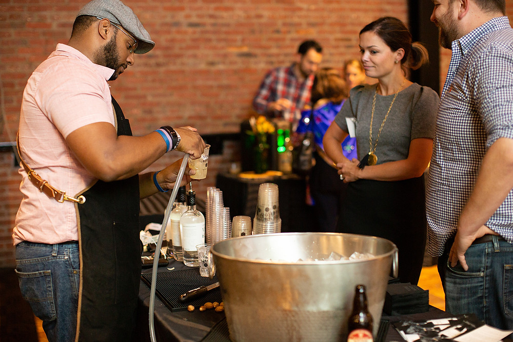 Craft brew being served by a bartender to guests at Farm to Chef Maryland 2019.