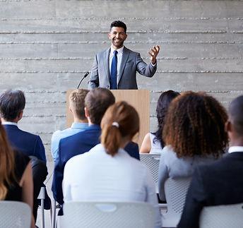 Businessman Addressing Delegates At Conf