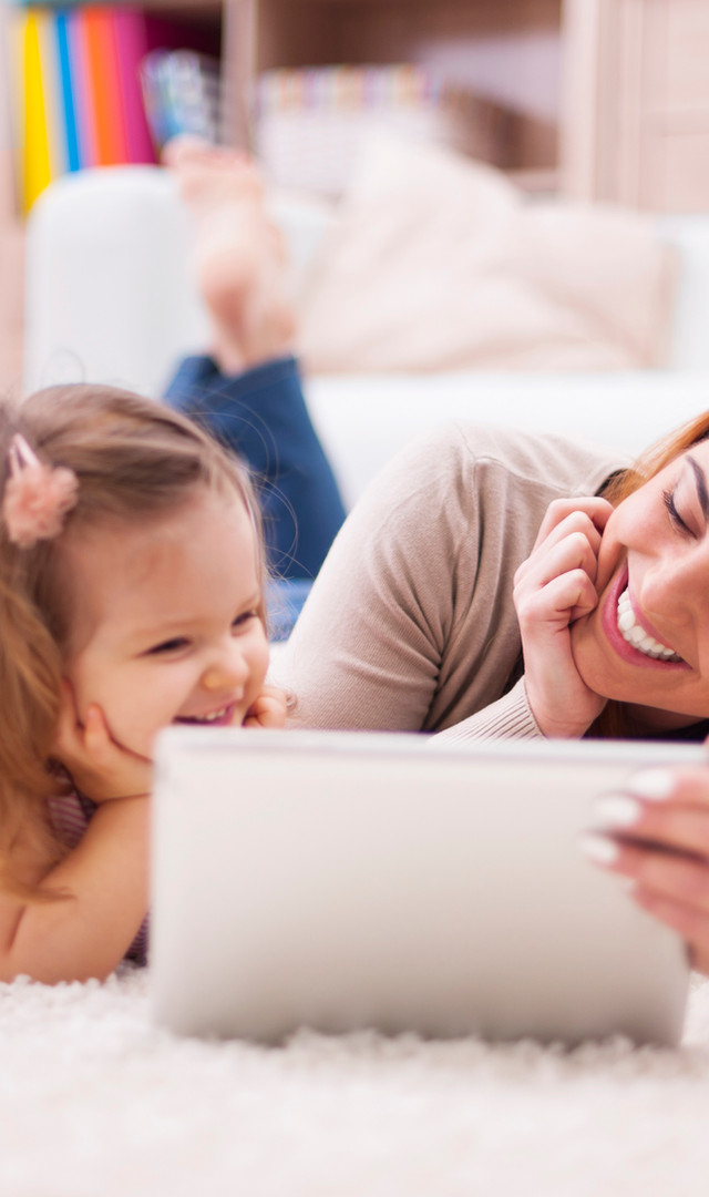 cute-little-girl-with-mom-using-digital-