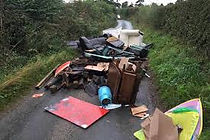 a picture of rubbish left by fly tippers. we would never do this