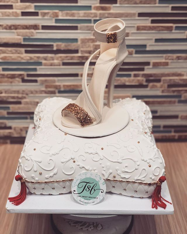Pillow cake with a stiletto on top. #tsb
