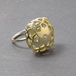 Secret Sound Ring. 18ct gold and diamond. The flower cage contains a solid gold bead..