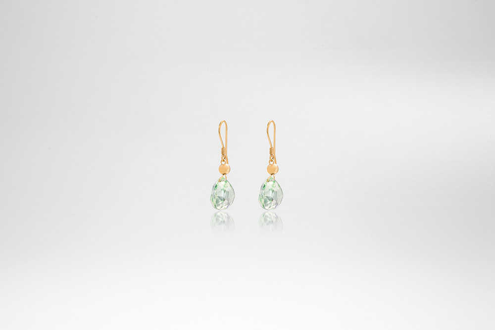 An elegant classic earring in popular Green Amethyst. The stones are faceted in a checker cut, 12mm heart shape.  Designed in collaboration with Ms Birgith , using recycled materials