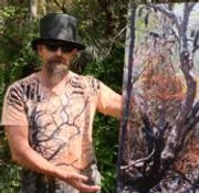 Rob Roy with his Digital photo painting artwork titled Corroboree. This can be seen at the Tall Tree