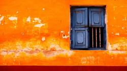 orange-building-w-window-a18447924