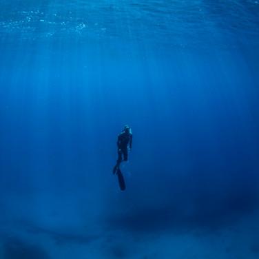 Talus Carpenter in the deep blue, Oahu, HI