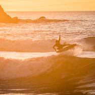 Casey launching during a golden sunset