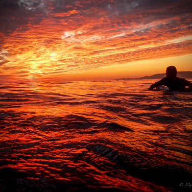 John Campo paddling into the sunset, Isla Vista, CA
