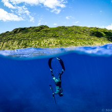 Talus Carpenter taking a drop off Oahu, HI