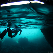 Myself swimming through a cave off the Channel Islands, CA. Photo taken by Sutara Nitenson, edited by myself.
