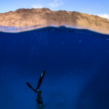 Talus Carpenter going deep. Oahu, HI.