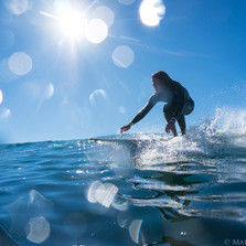 Marcos surfing through the mid morning sun.