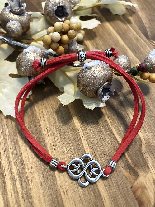 Infinity Knot in Deep Coral