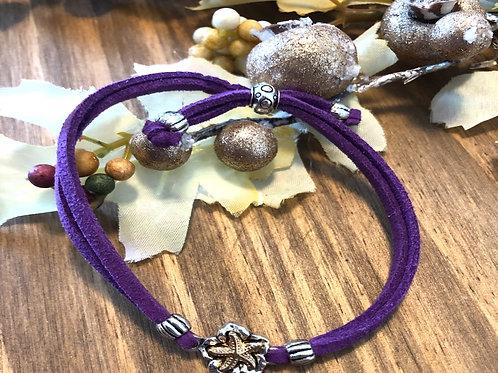 Tiny Golden Starfish in Purple