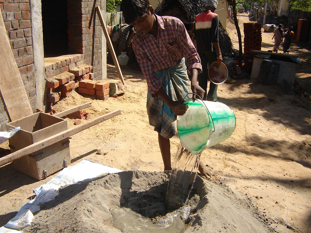Water is added by making hollow in the top of the pile for making the mortar paste.