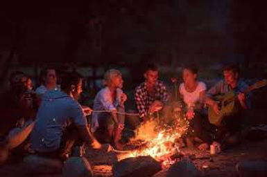singing with friends aroudn a fire.jpg