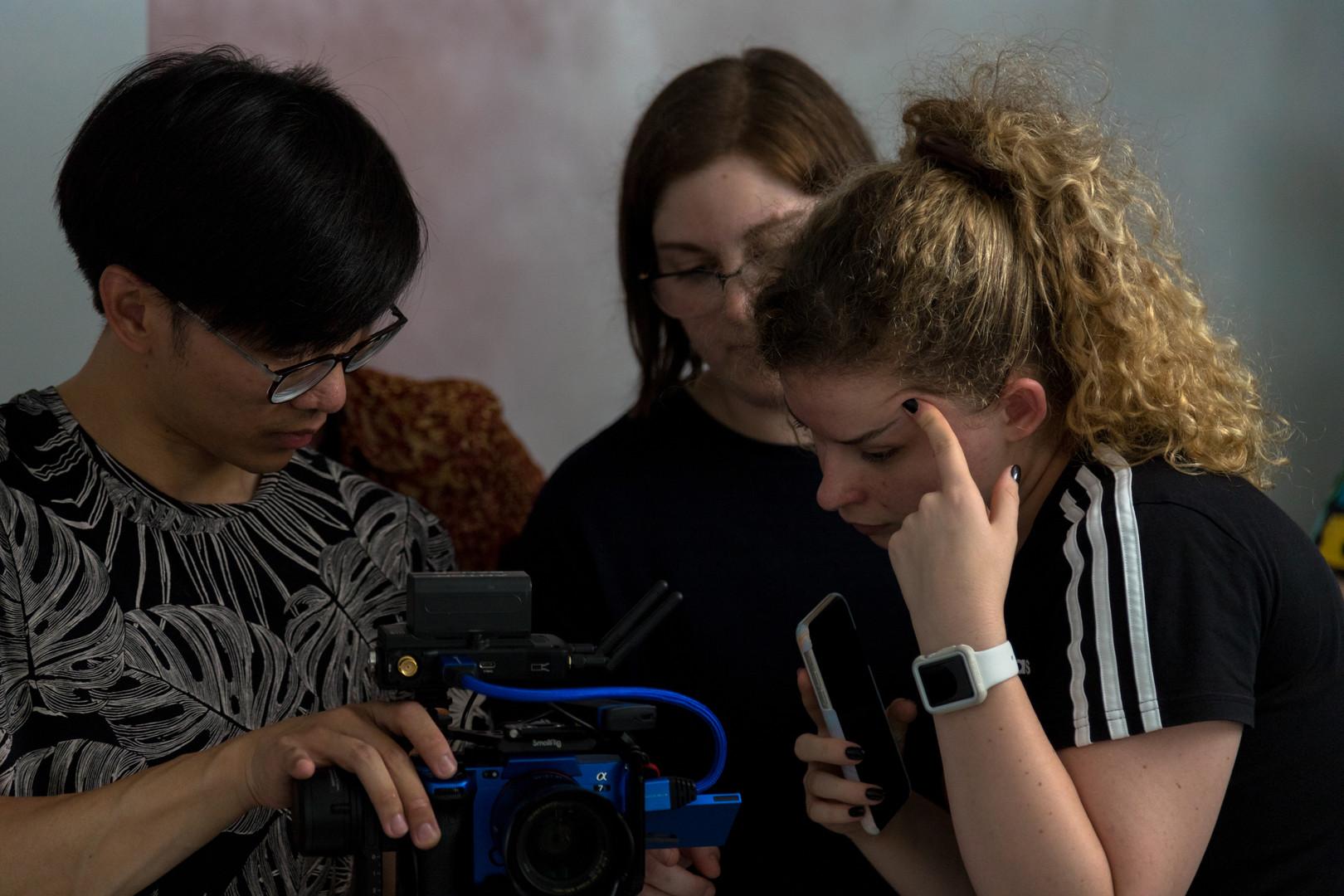 Watching playback - Amanda Kaye, Chris Chung and Ainsely Brosing