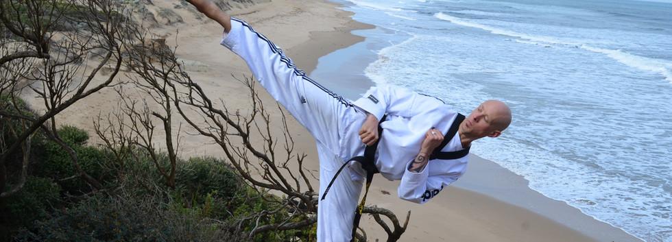 Master Al performing Taekwondo kick in Torquay