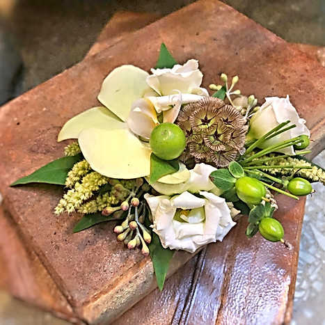 Textural wristlet w\orchids,berries,pods, grasses.jpg