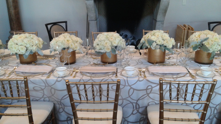 Beautiful gold containers filled with garden roses.jpg