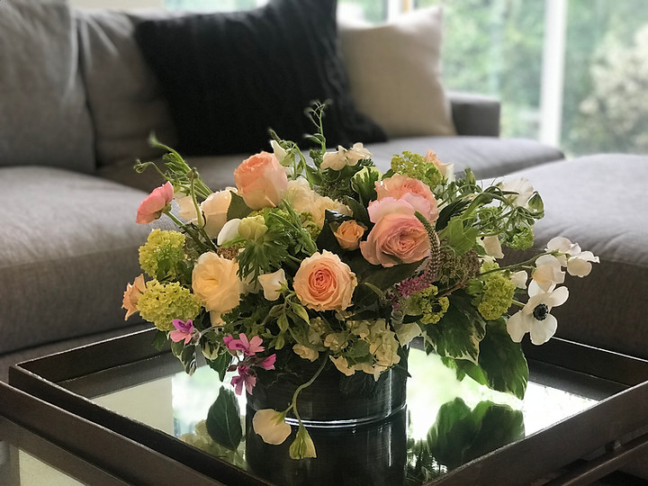 wonderful garden arrangement in low leaf lined glass vase