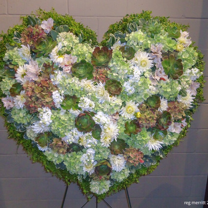 Huge 4' Heart with mixed flowers including hydrangeas,succulents etc..jpeg