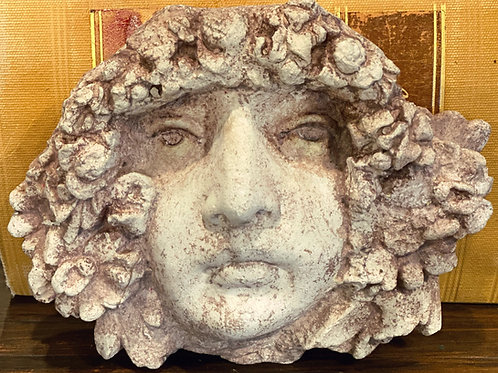 Cast-stone face, with aged patina finish