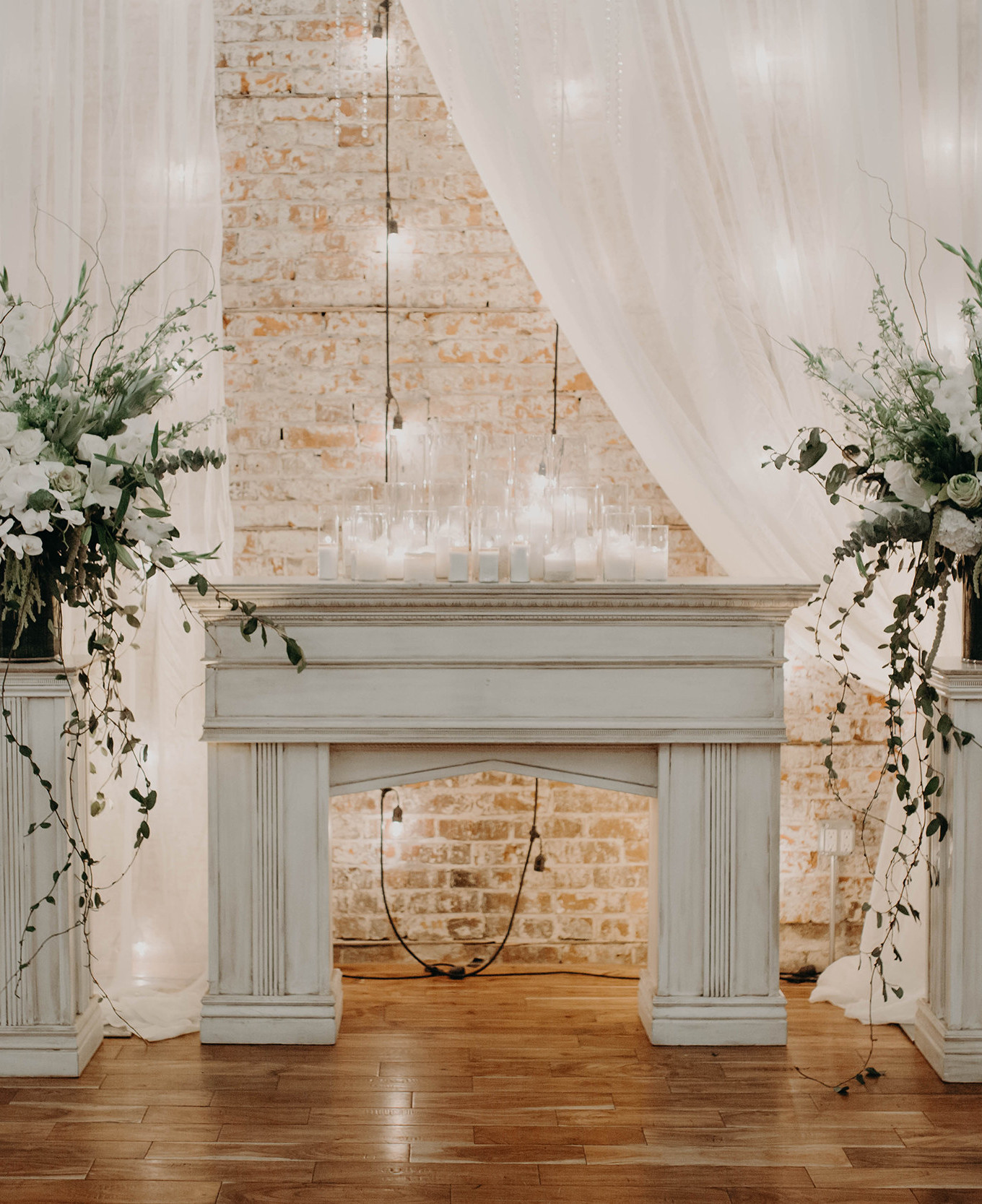 KC Wedding@ undisclosed location. Two Large white and creme pedestal arrangements for ceremony.JPG