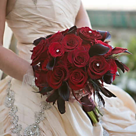Dramatic red roses w/ complimenting feathers natural stems ribbon wrapped.jpg