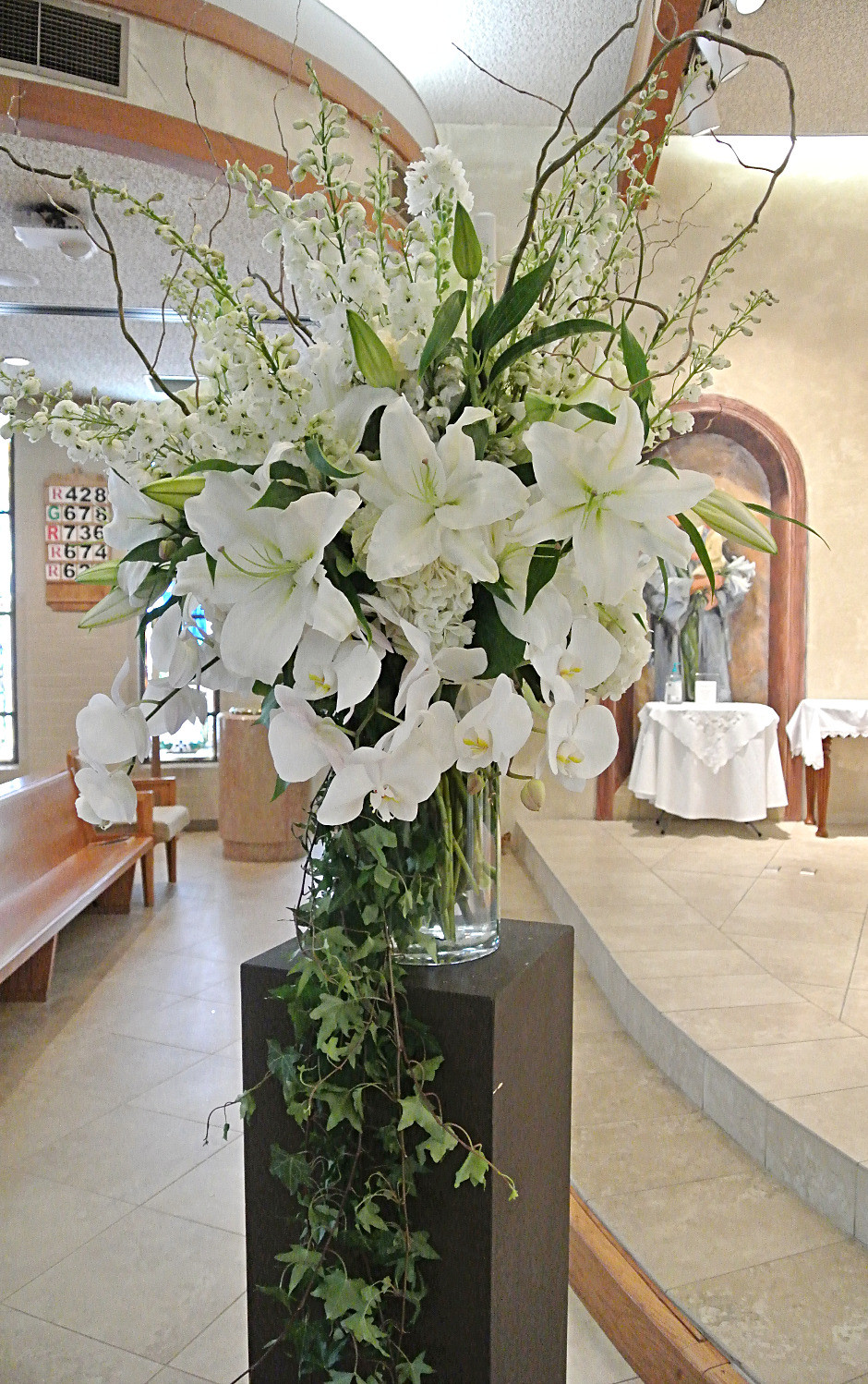 Beautiful all white pedestal arrangement.jpg