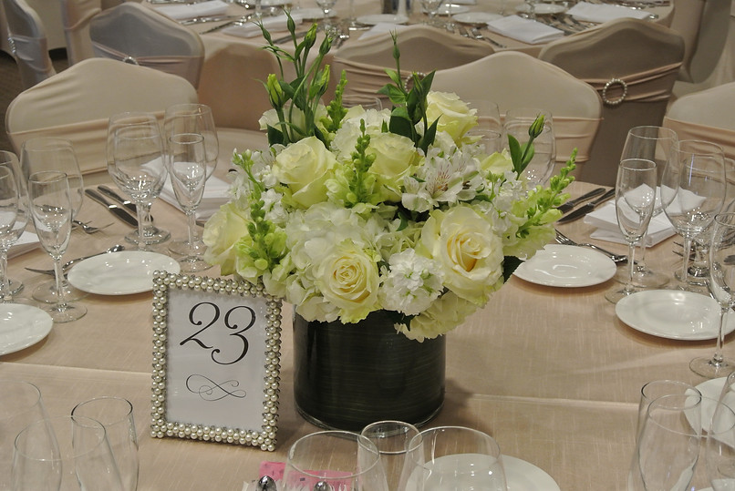 White and creme arrangement in leaf lined cylinder.JPG