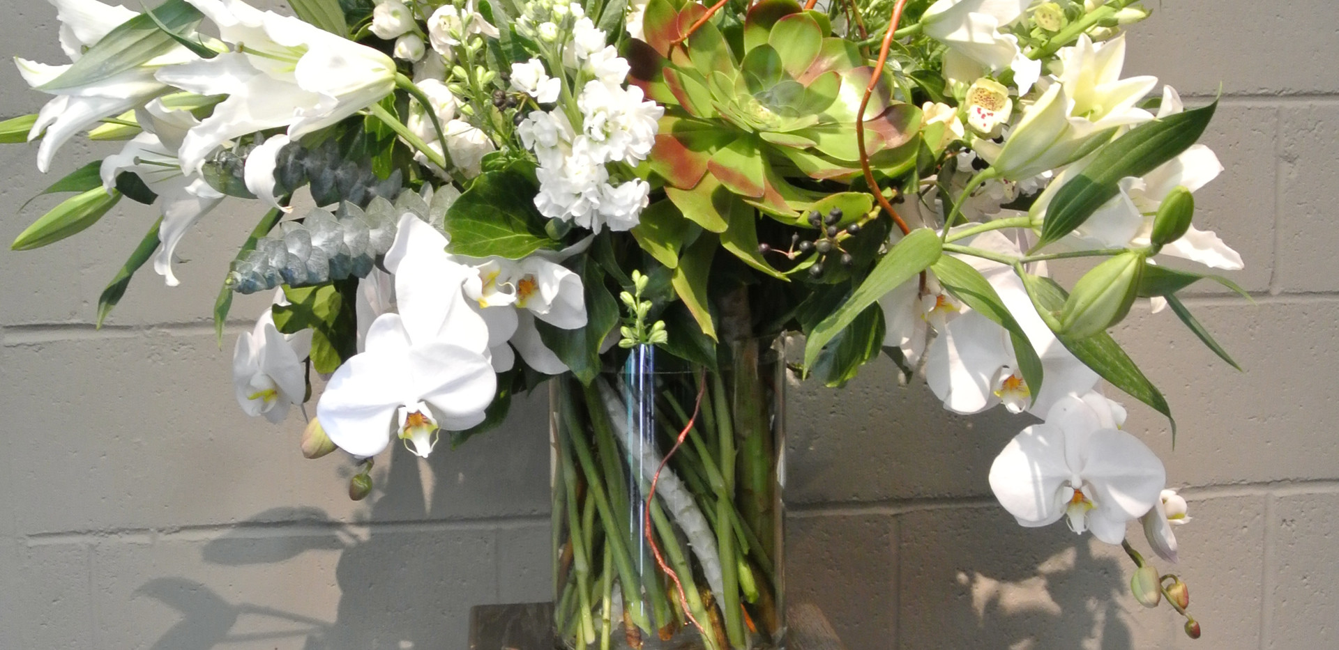 All white in a glass cylinder pedestal arrangement.JPG