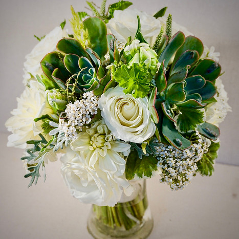 Beautiful whites,cremes,greens and succulents with natural stems and ribbon wrapped.jpeg