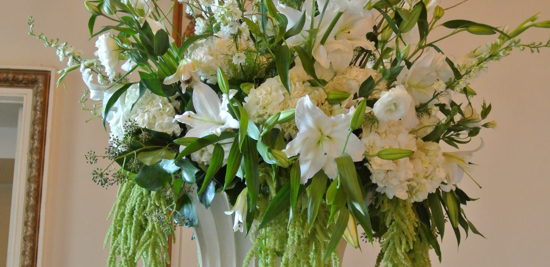 urn arrangement in whites ,cremes, greens on pedestal.JPG
