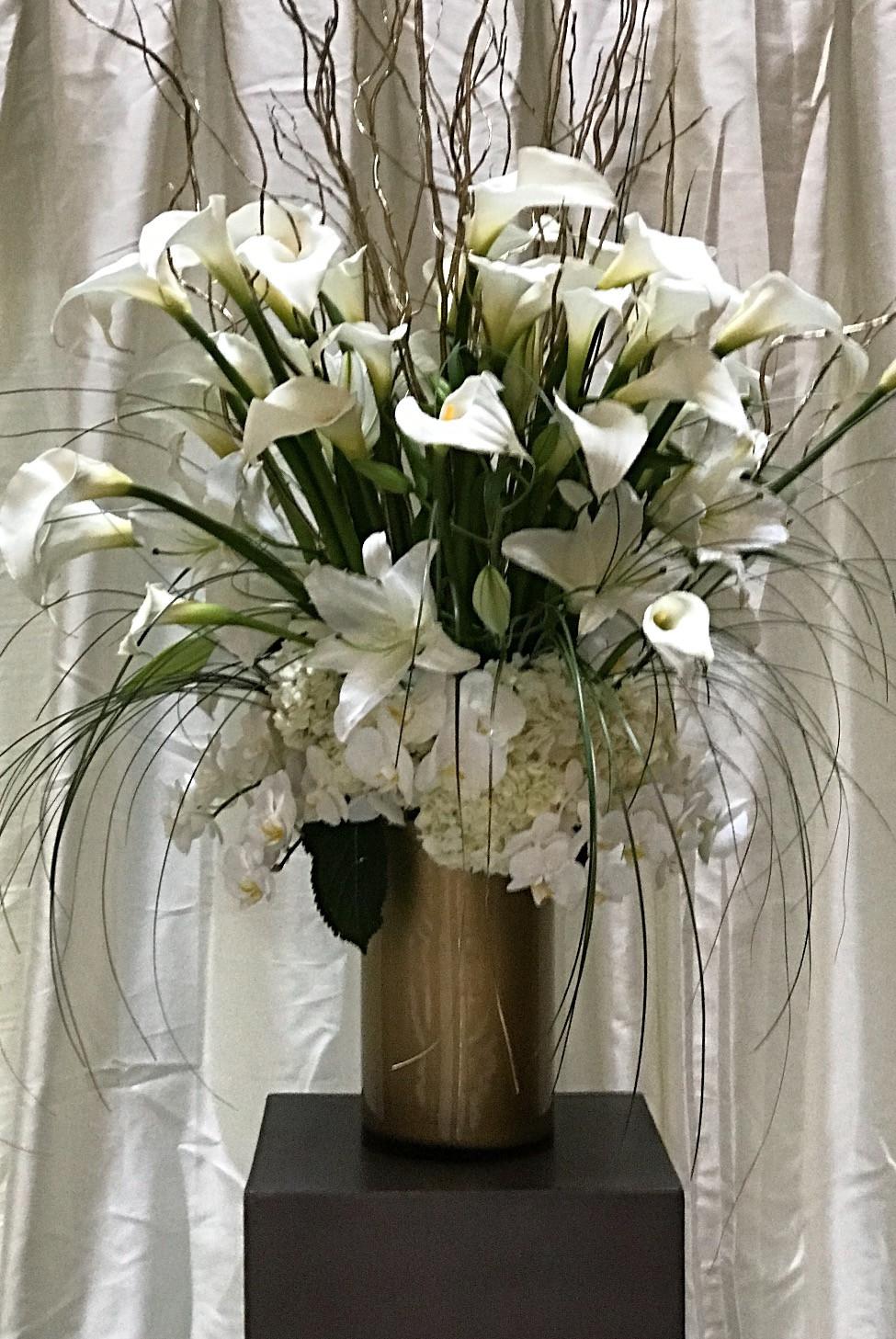 Calalily,orchids,twig, and bear grass pedestal arrangement.jpg