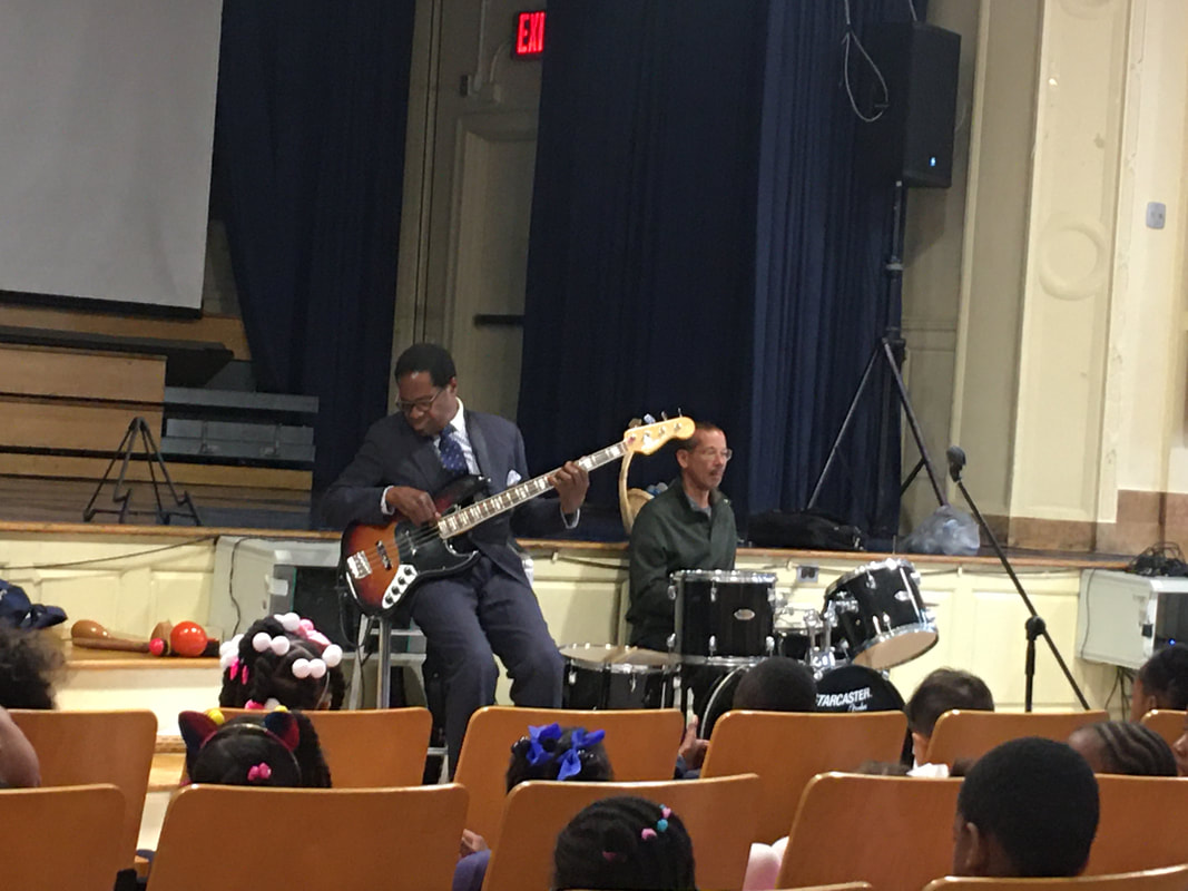 Jazz bassist and drummer perform