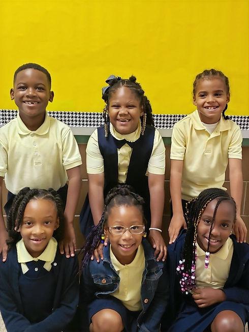 Ms. Dellimore's students in PS 233 unifo